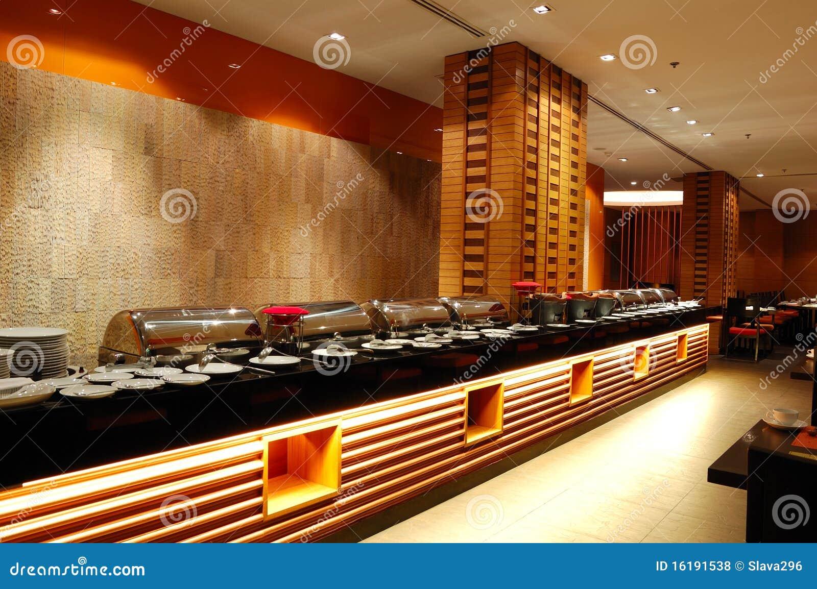Modern restaurant interior in night illumination royalty