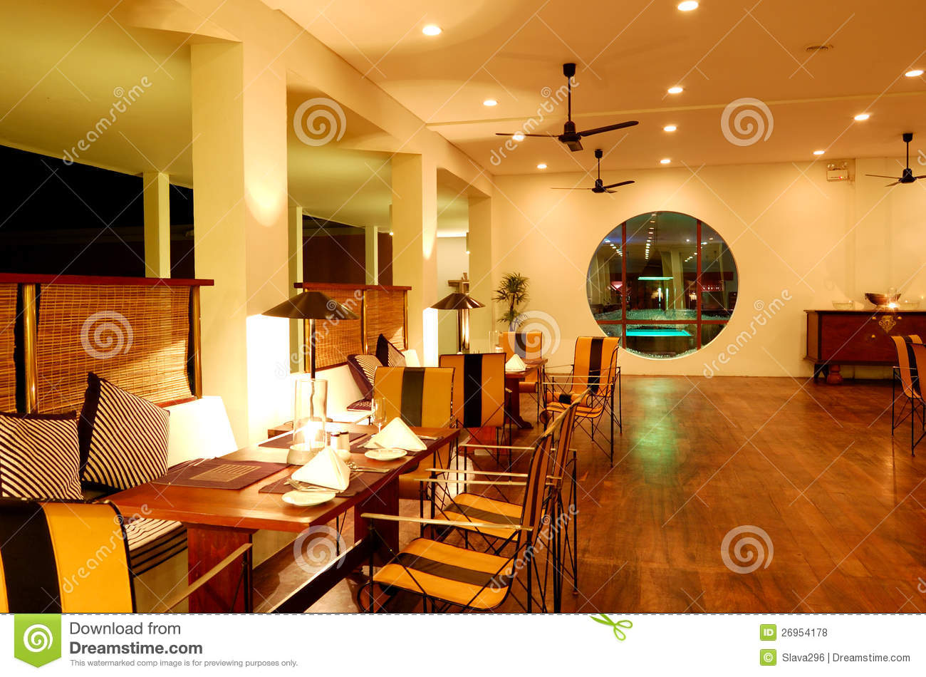 Modern restaurant interior at night illumination stock