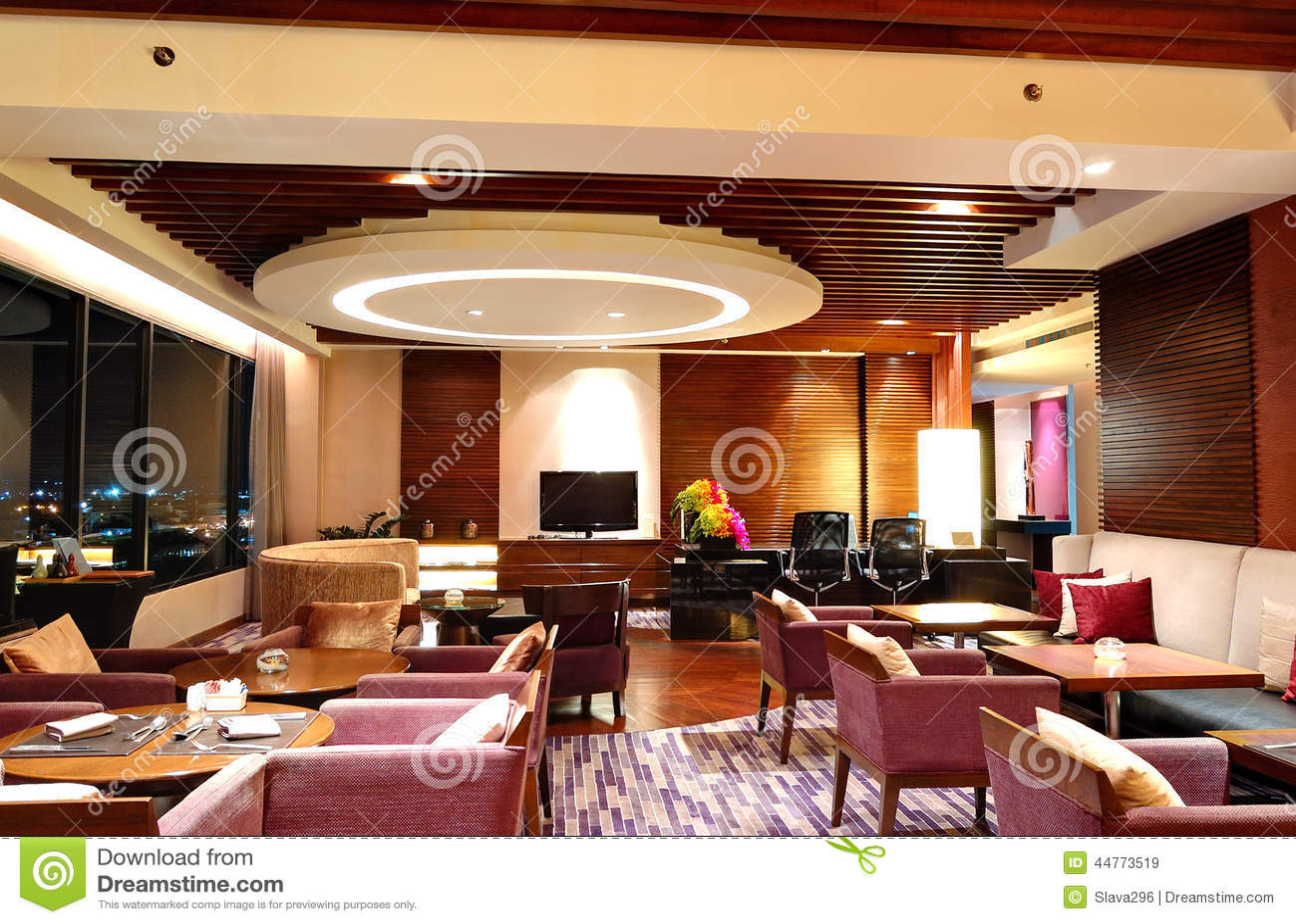 Modern restaurant interior in night illumination and city