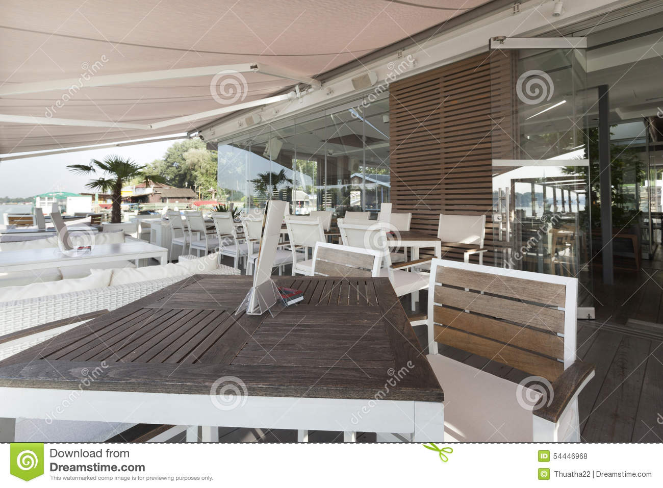 Modern riverside cafe interior in the morning