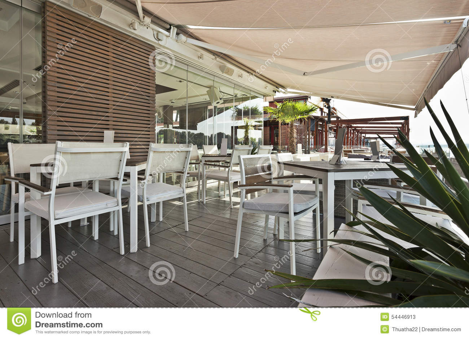 Modern riverside cafe terrace in the morning