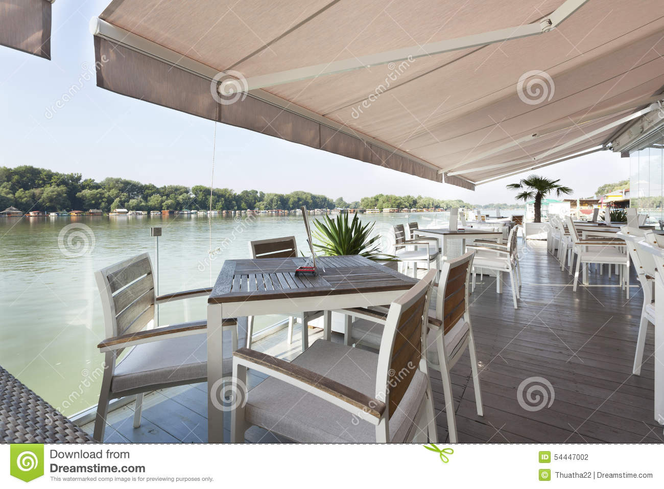 Modern riverside cafe terrace in the morning