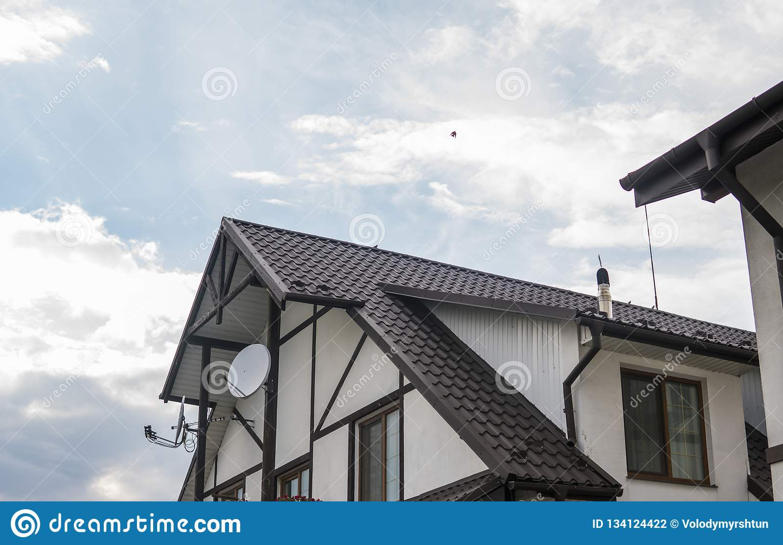 Modern Roof Covered With Tile Effect Pvc Coated Brown Metal Roof Sheets Against Cloudy Sky Stock Photo Image Of Exterior Design 134124422