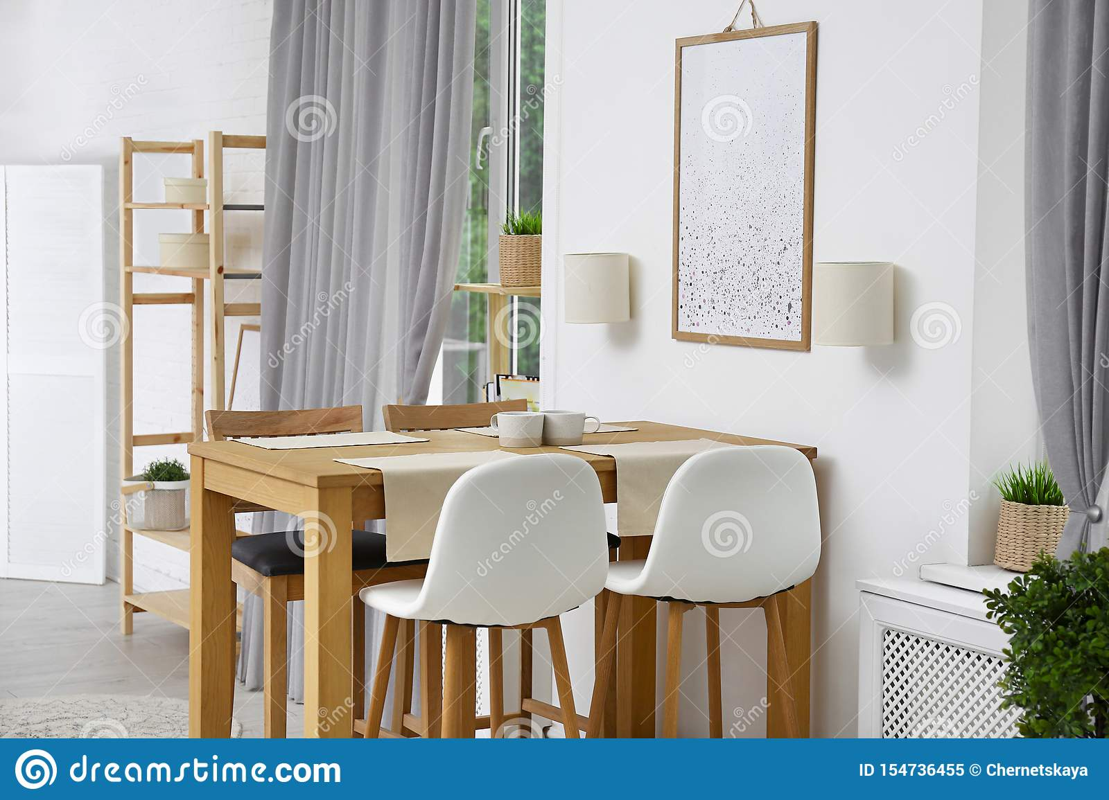 Modern room interior with wooden table