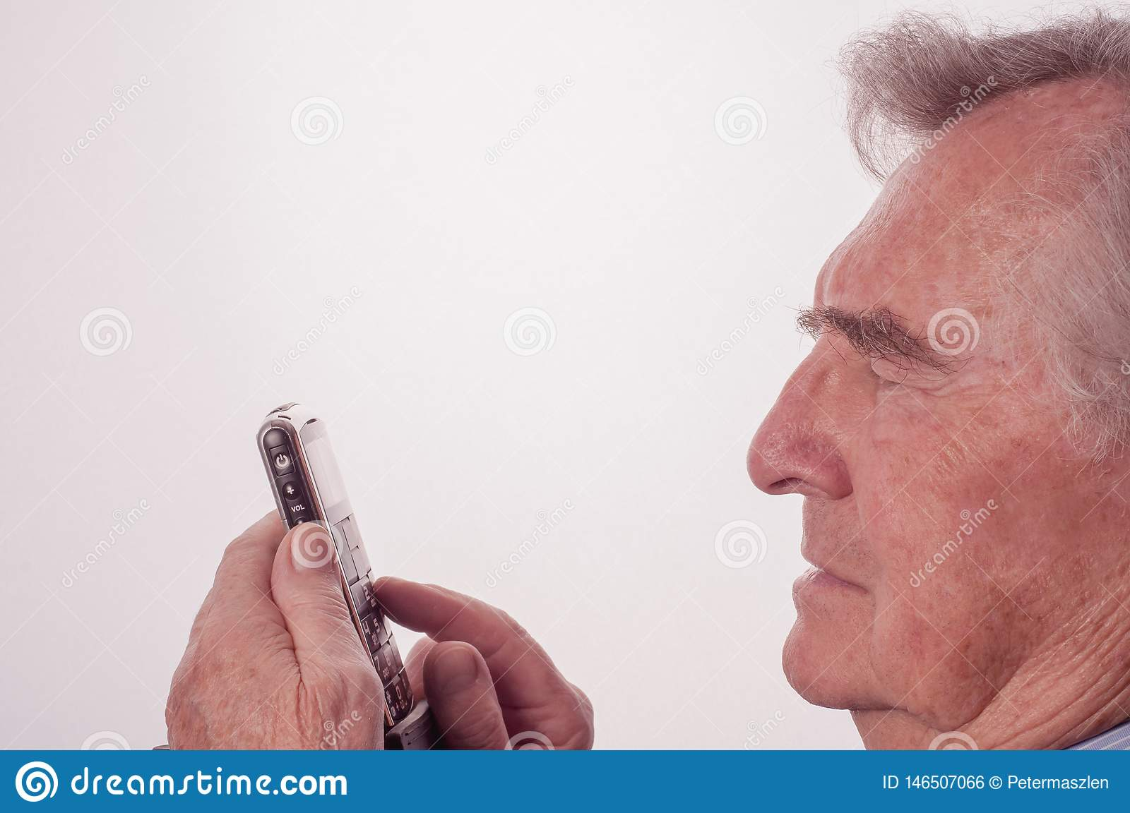 Senior man having problems with his mobile phone