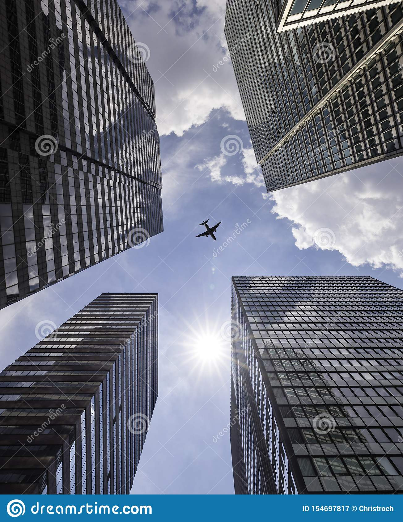 Modern skyline with passenger plane flying over business skyscrapers, high-rise office buildings of Manhattan, New York