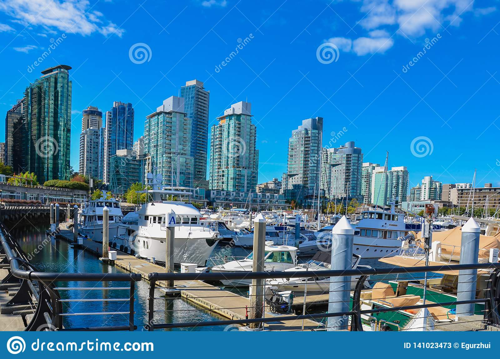 Marina and modern buildings in Vancouver, BC.