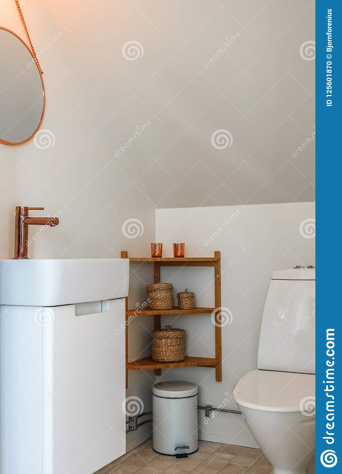 Modern Small Toilet Room With Copper Details Stock Photo