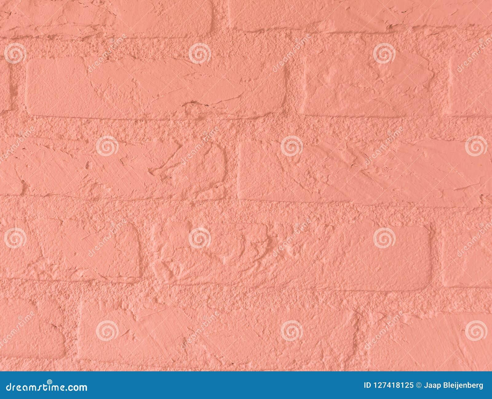 Modern soft light pink stone brick wall build of big stone bricks vintage background pattern