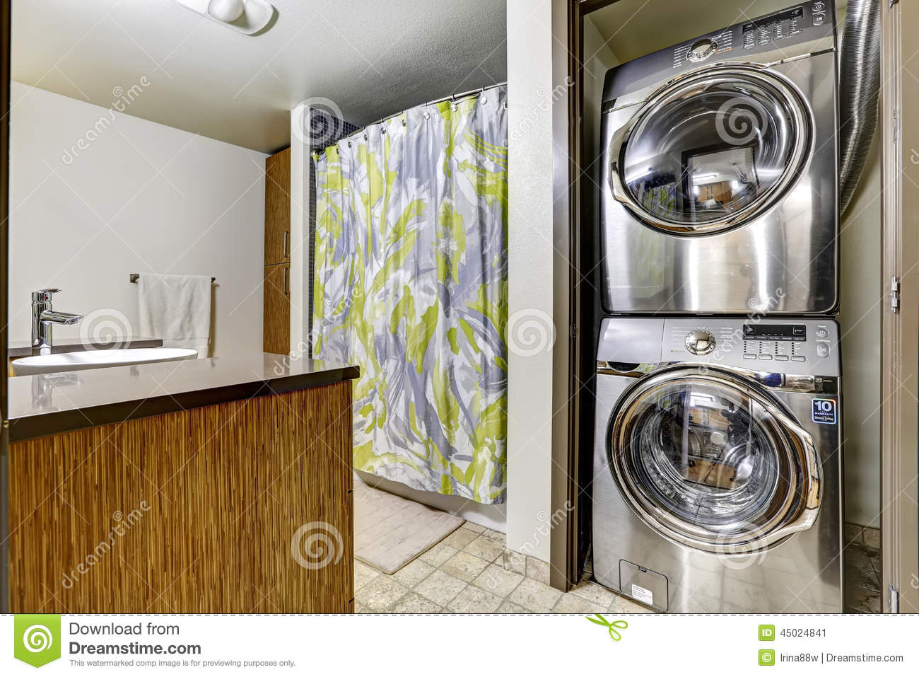 Modern steel laundry appliances in bathroom stock photo for Restroom appliances
