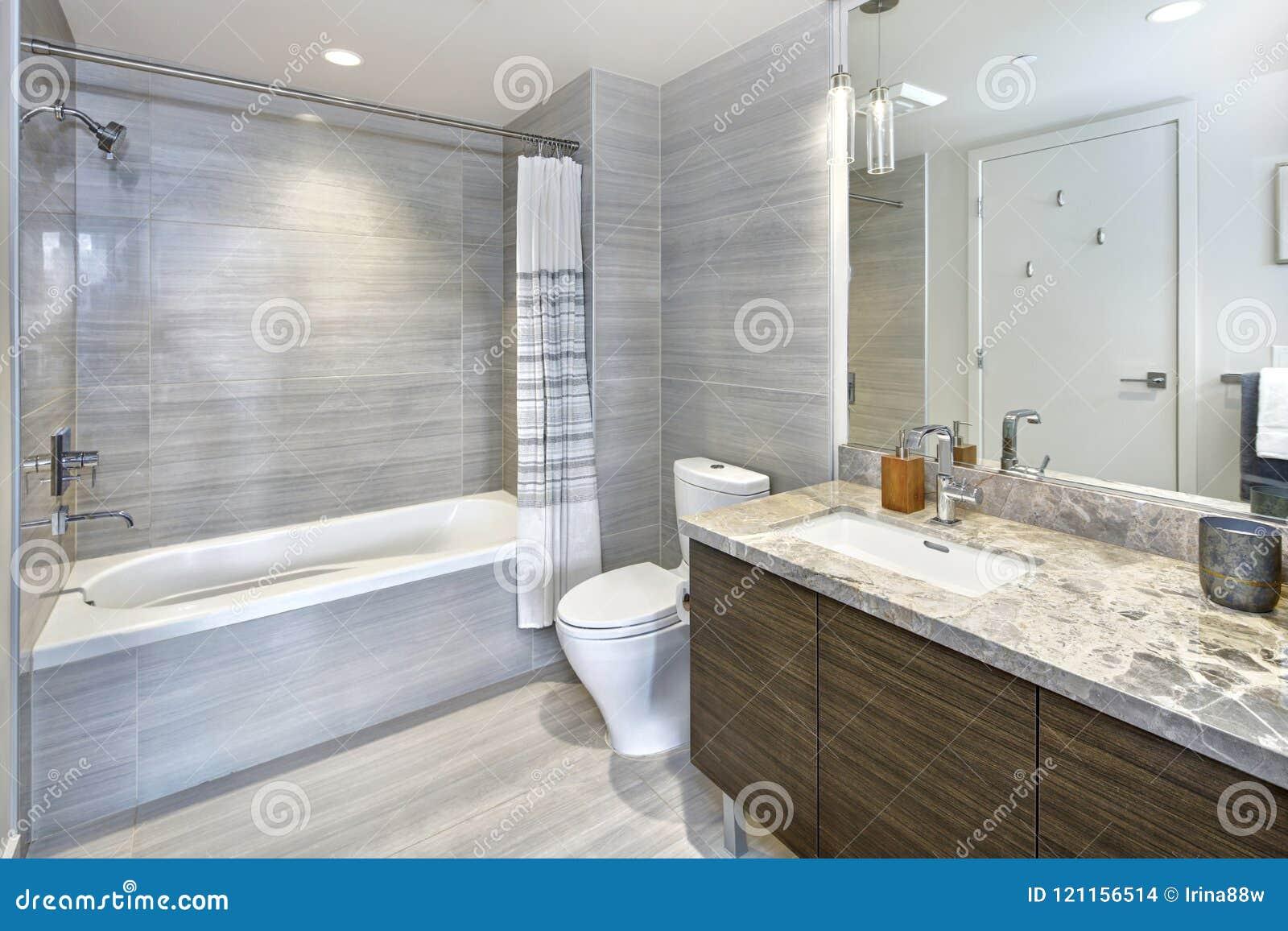 modern stylish condo bathroom design with gray tiling stock photo rh dreamstime com