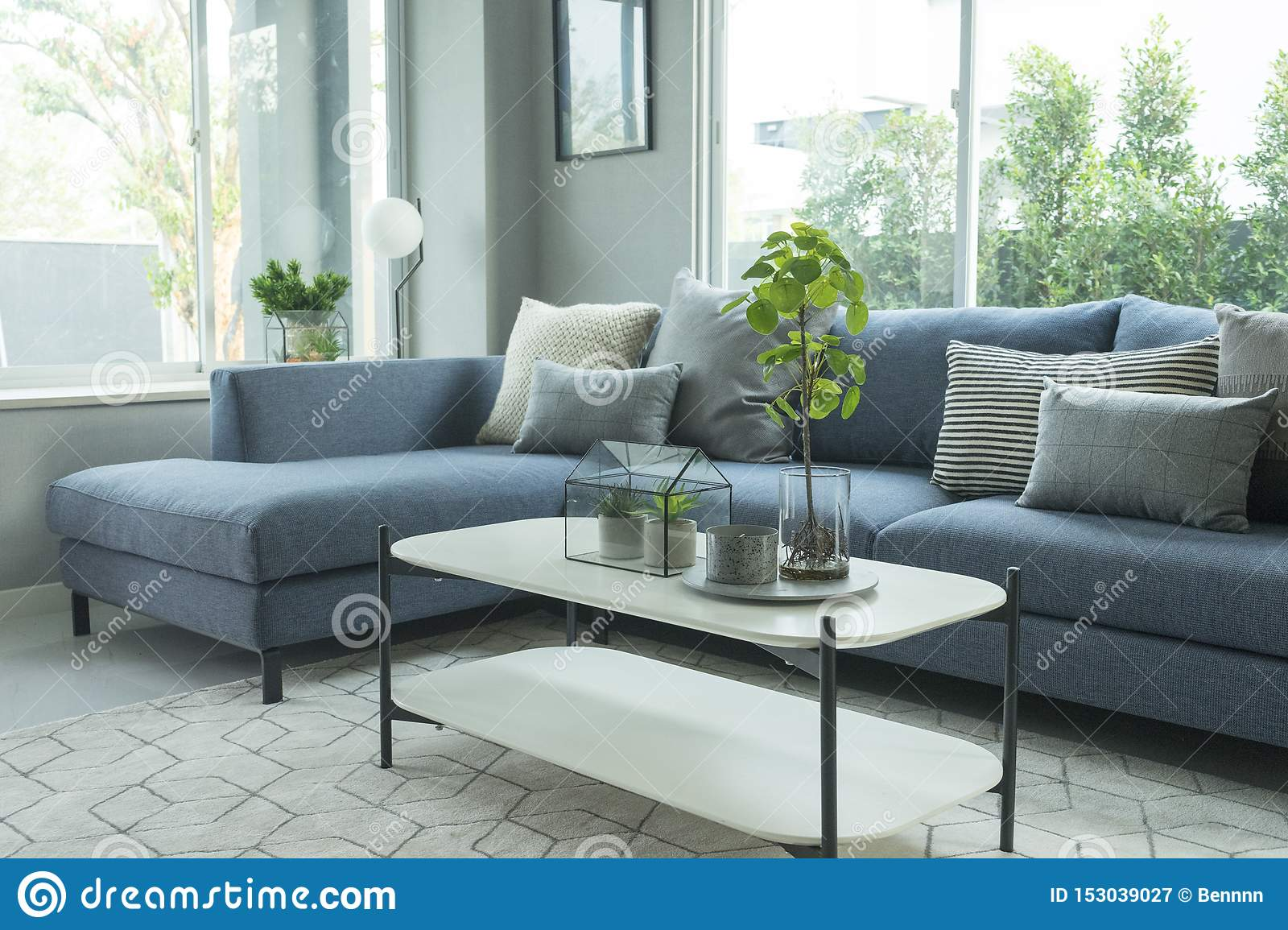 Modern And Stylish Living Room Blue Sofa And Grey Pillow With Coffee Table Stock Image Image Of Home Design 153039027