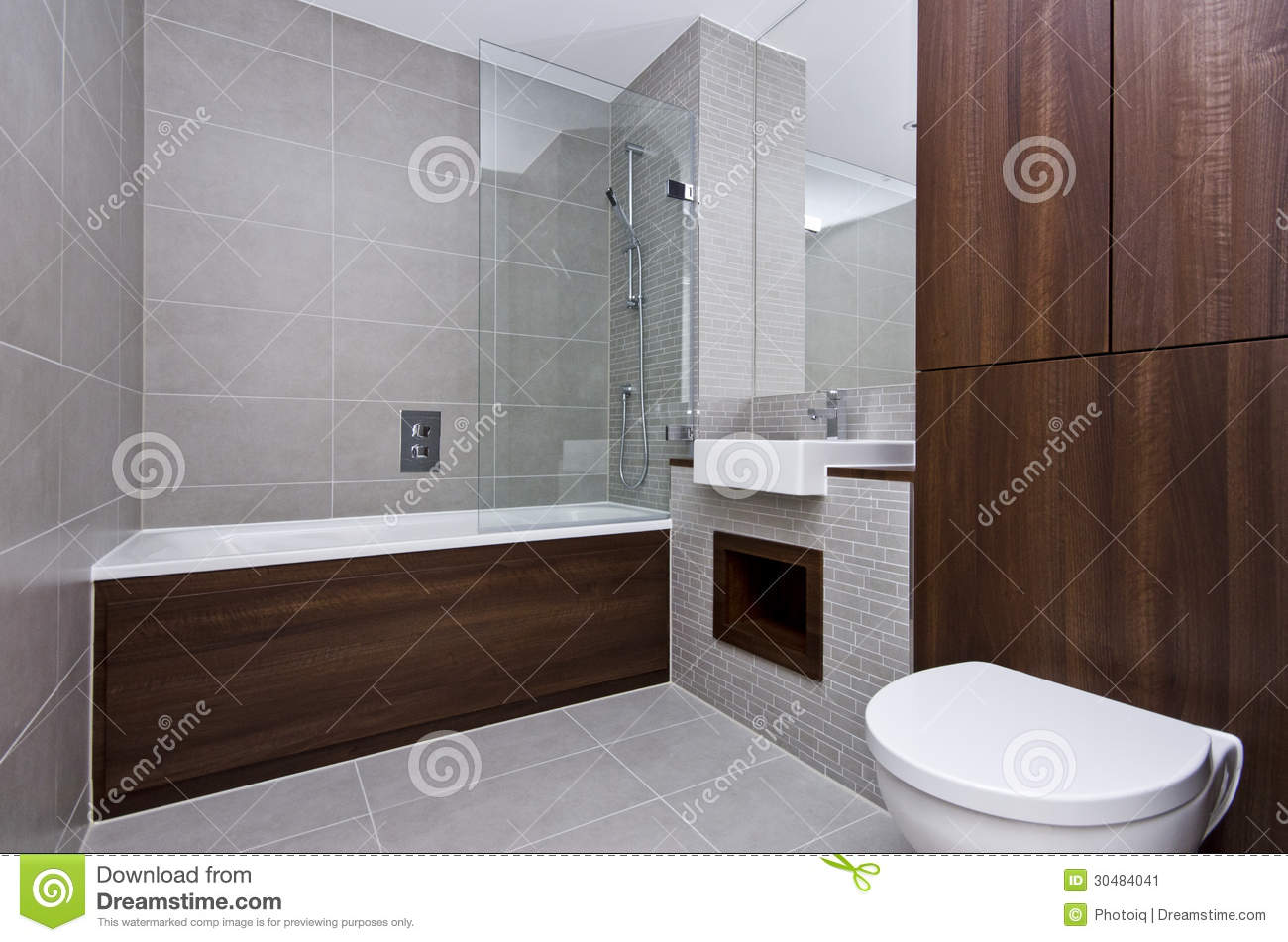 Modern en suite bathroom in beige with black tiles royalty for Small 4 piece bathroom designs