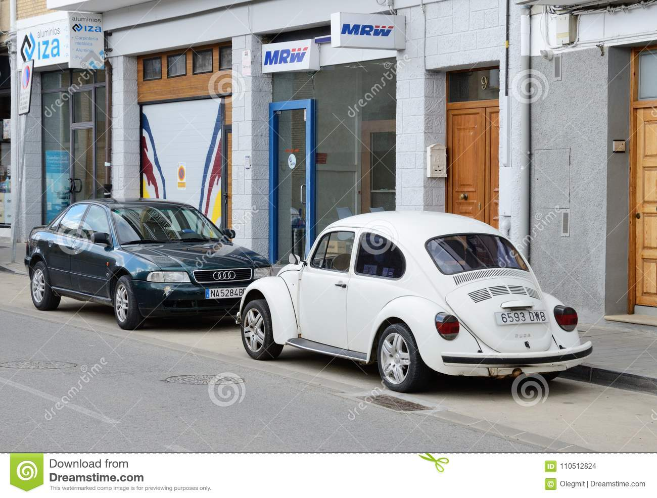 Modern And Vintage Cars Parked In The Street Editorial Stock Image ...