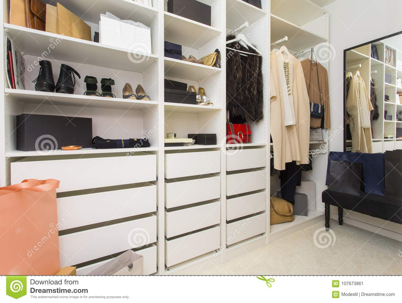 Modern walk in closet with luxury shoes and bags