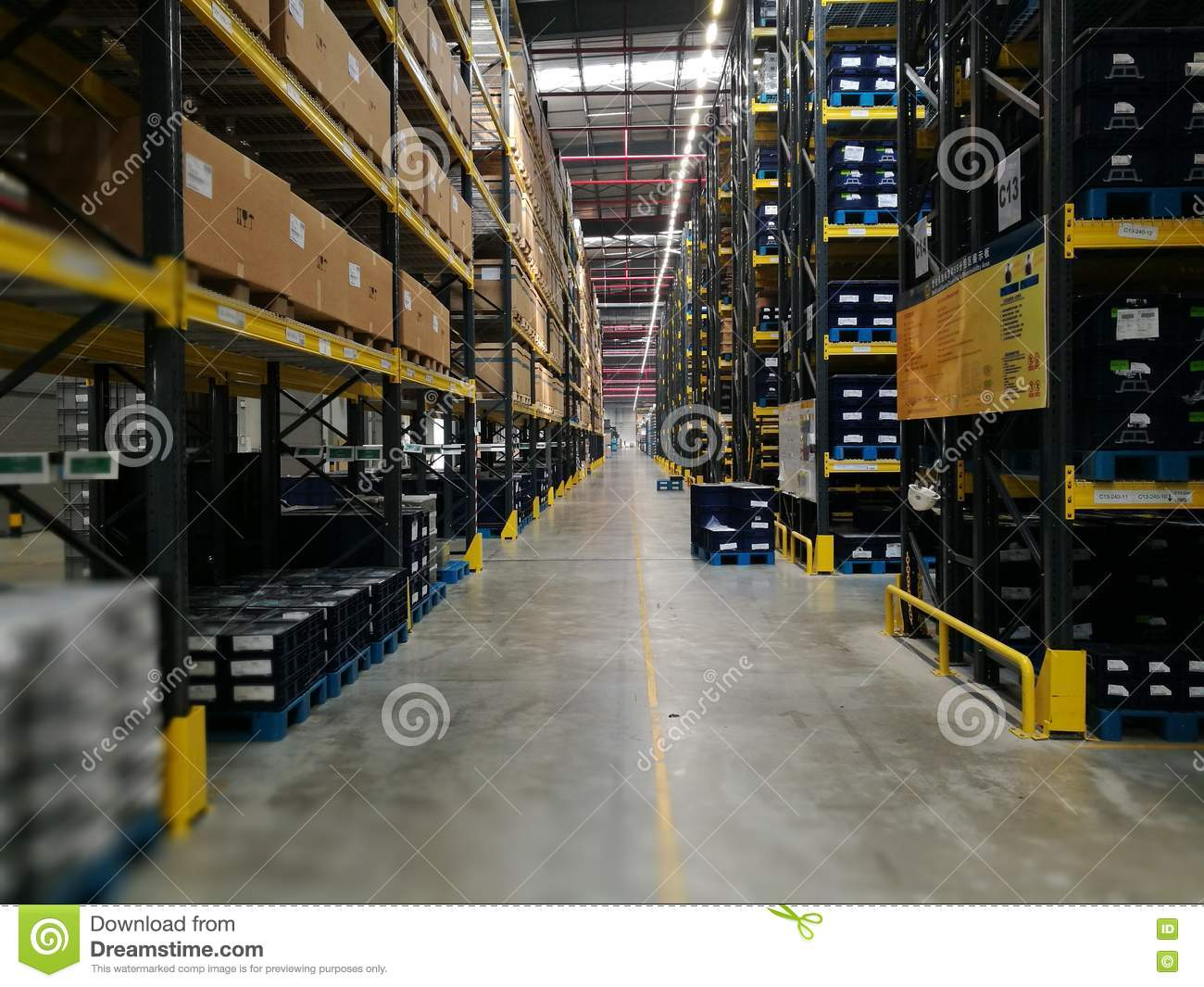 Modern warehouse within plastic boxes and the shelf stocking raw material