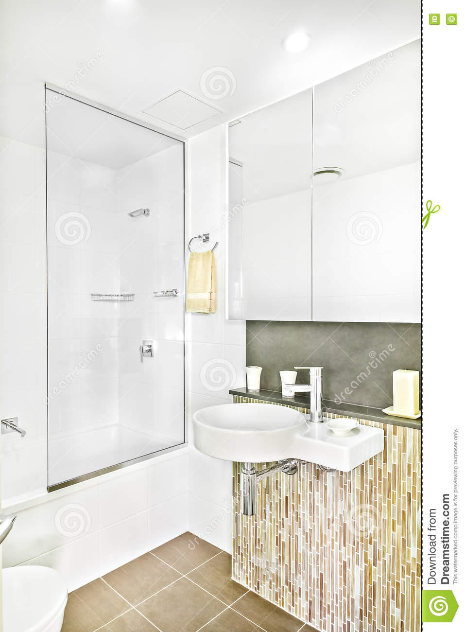 Modern wash room near mirror with tiles.