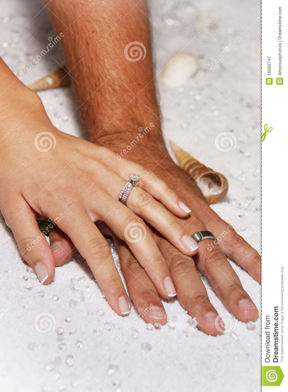royalty free stock photography modern wedding hands white sands image modern wedding rings Modern Wedding hands in white sands