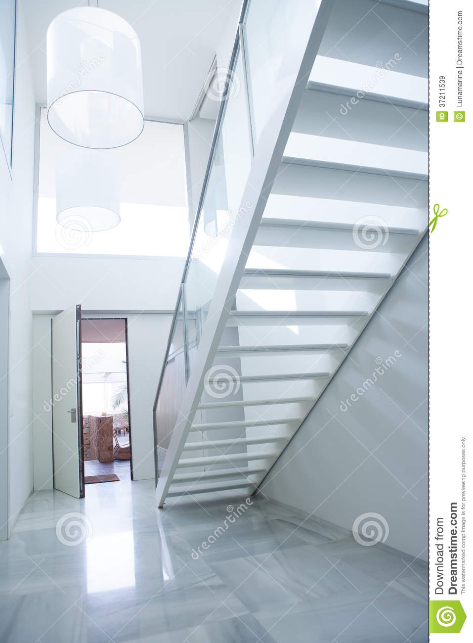 Modern white house entrance hall lobby with stairway stock for Entree escalier decoration
