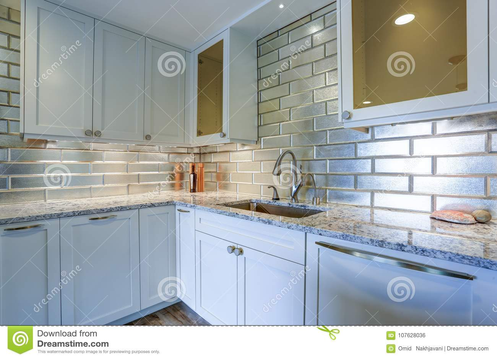 Modern White Kitchen Design With Silver Backsplash Stock Photo ...