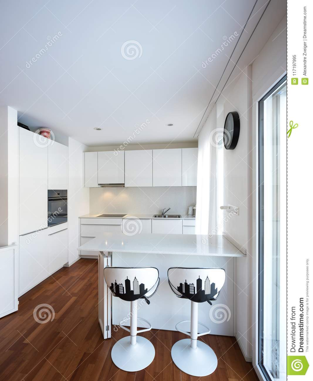 Modern White Kitchen With Peninsula Stock Image - Image of inside ...