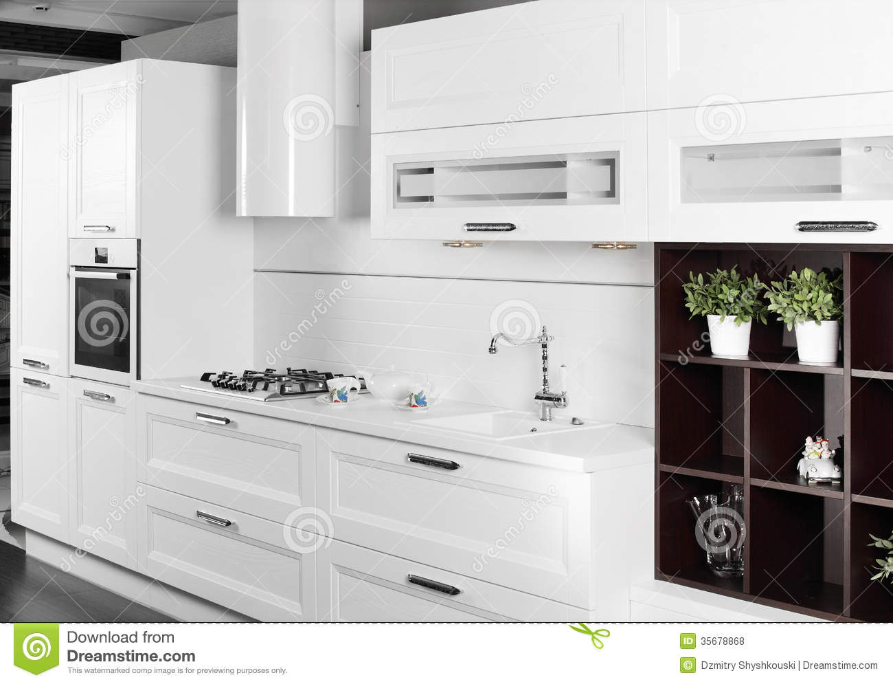 Modern white kitchen with stylish furniture royalty free for Armoire de cuisine shaker