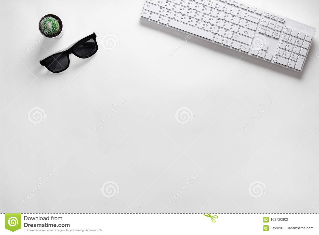 Modern white office desk table with desktop computer, cactus and eyeglasses. Top view with copy space, flat lay