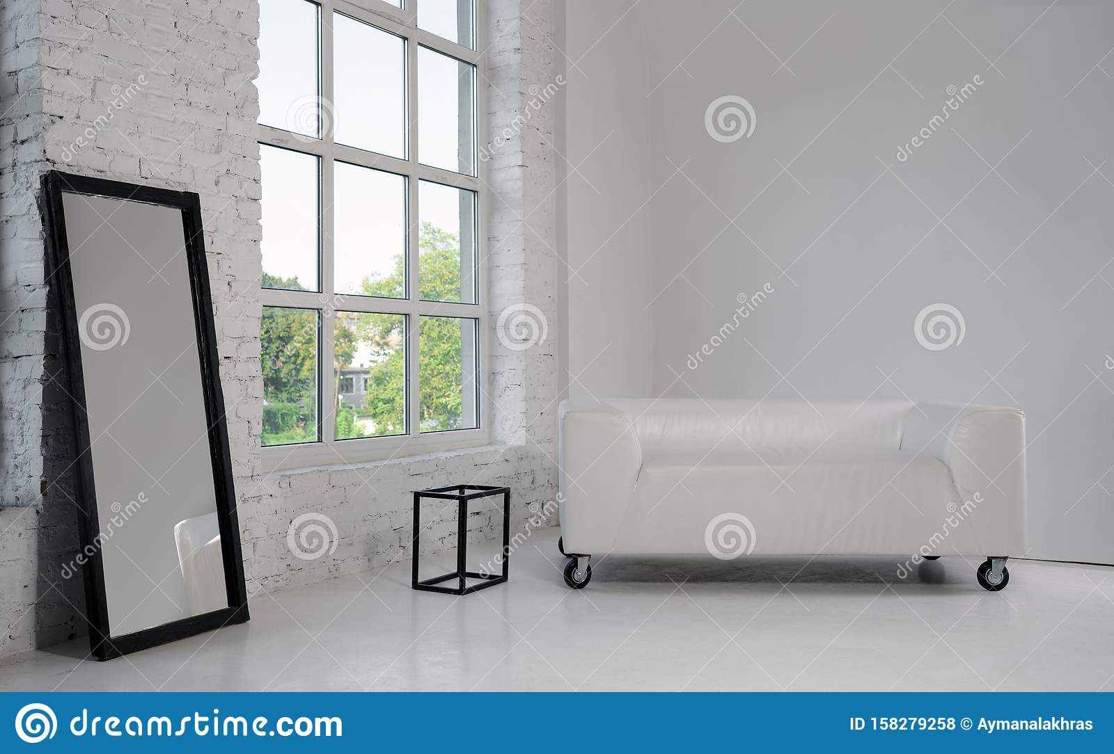 Modern White Sofa And Large Black Framed Mirror In White Minimalistic Room With Big Window Stock Photo Image Of Floor Brick 158279258