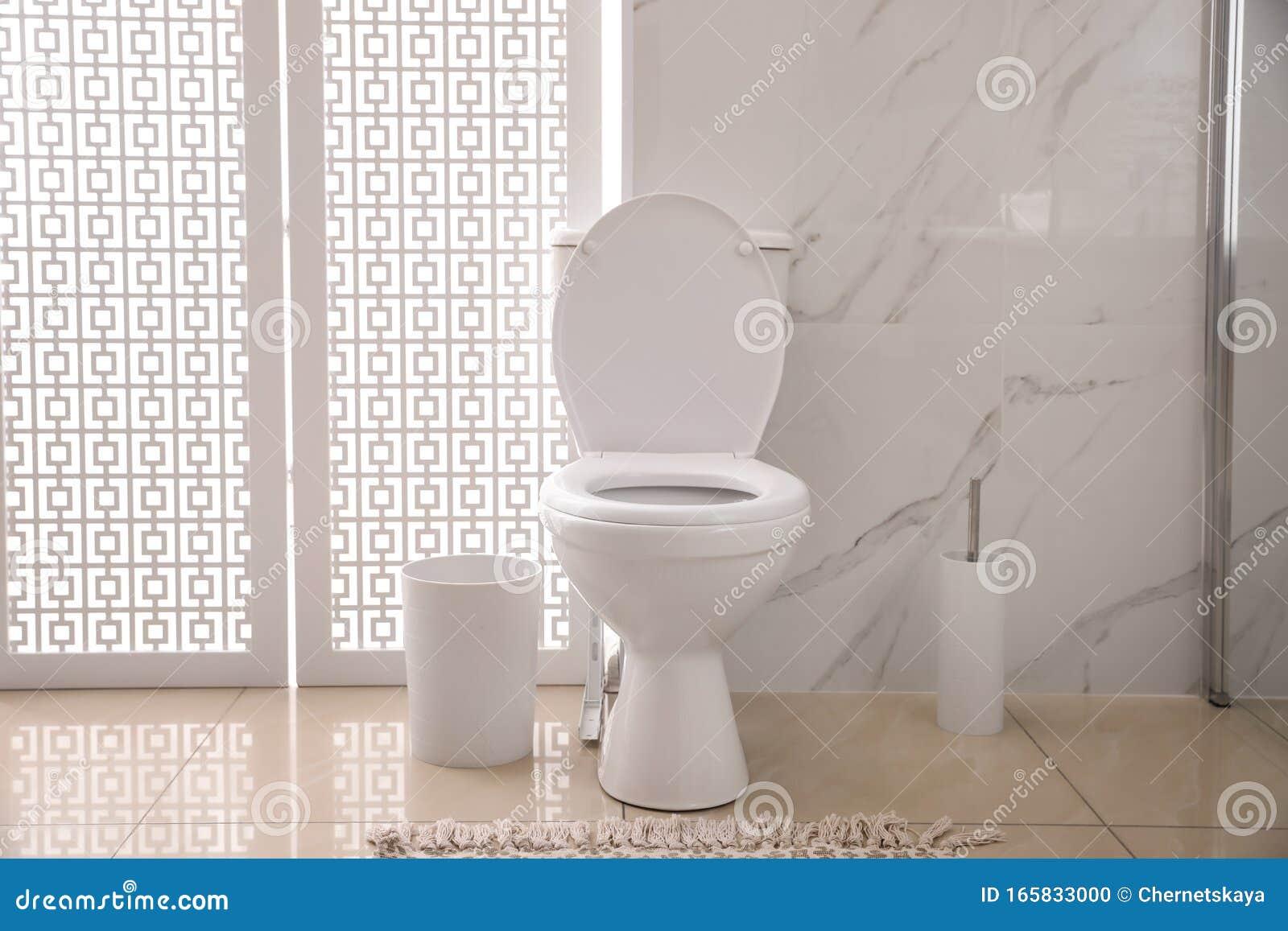 Modern White Toilet Bowl Near Marble Wall Stock Photo Image Of Interior Clean 165833000