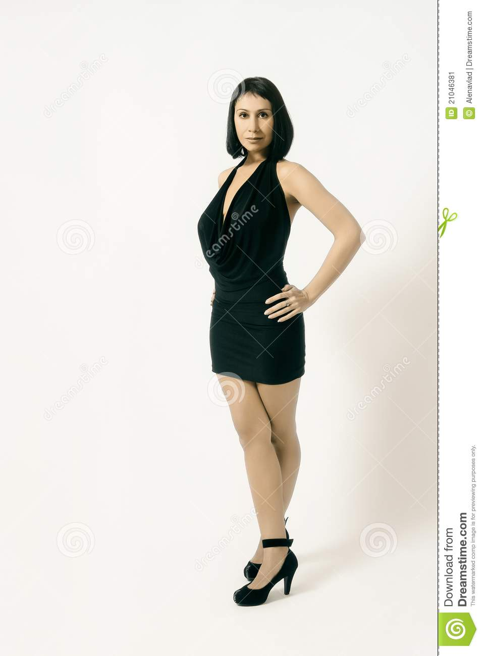 Elegant modern woman in black small dress with black hair and shoes