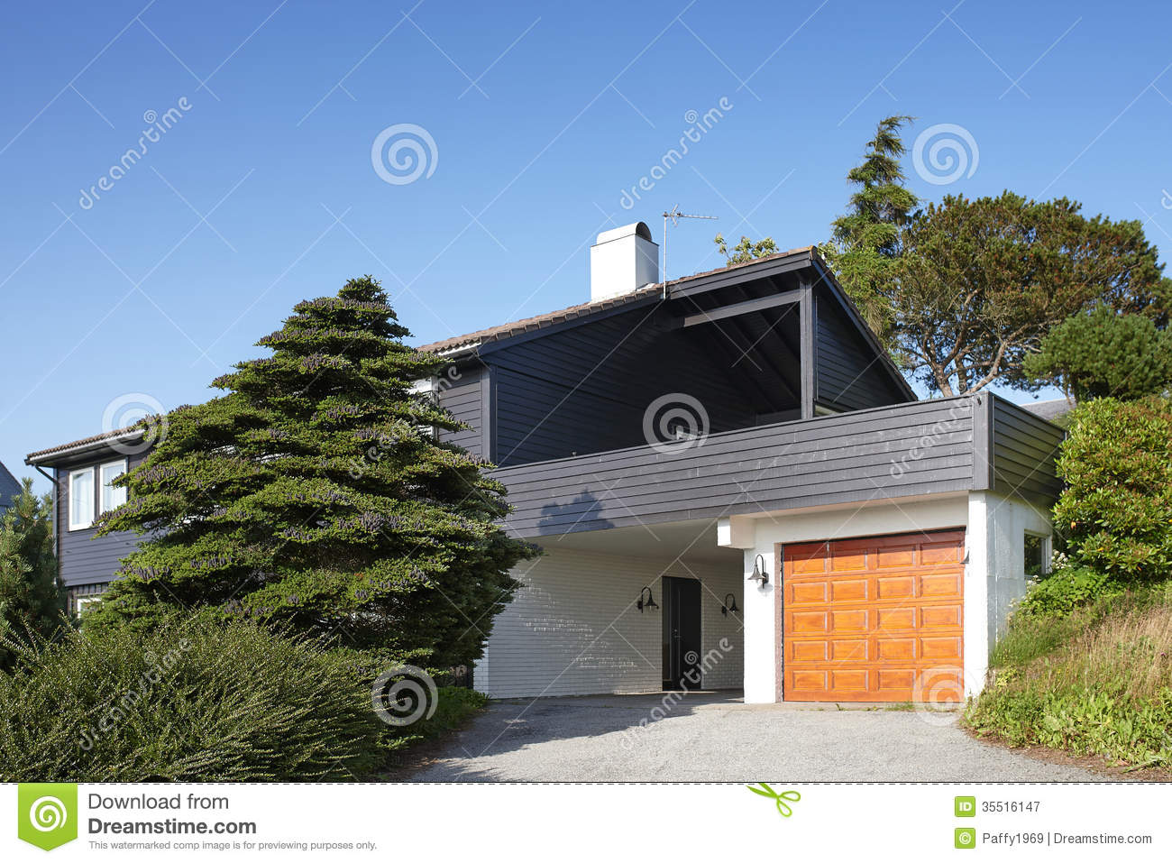 Modern wooden house with garage in norway stock image for Modern day houses