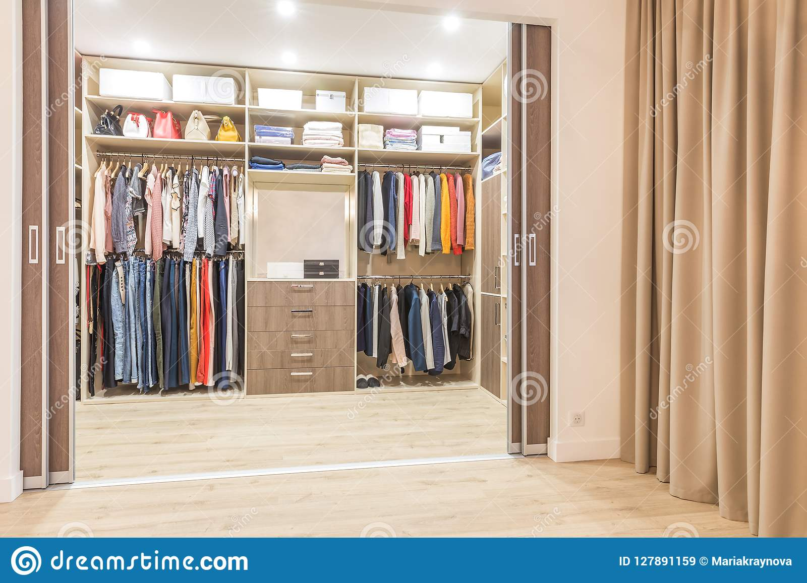 Modern Wooden Wardrobe With Clothes Hanging On Rail In Walk In Closet Stock Image Image Of Shelf Dress 127891159