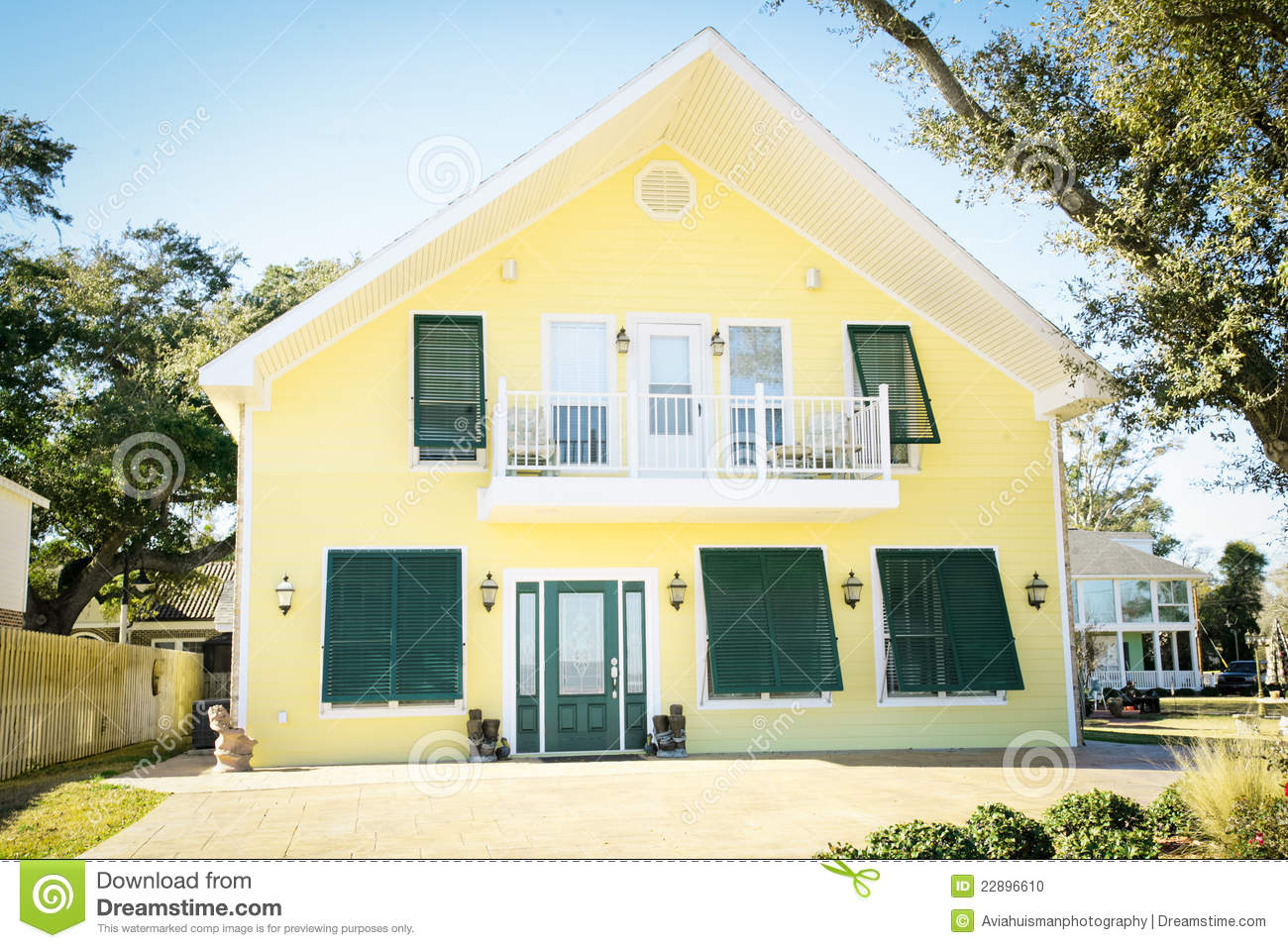 Modern southern style american home with white trim shutters and a balcony