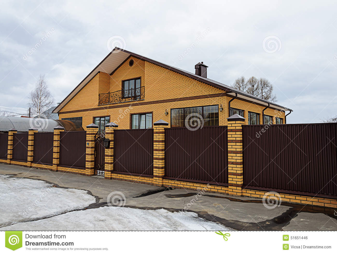 Modern yellow brick house with balcony stock photo image for Modern yellow houses