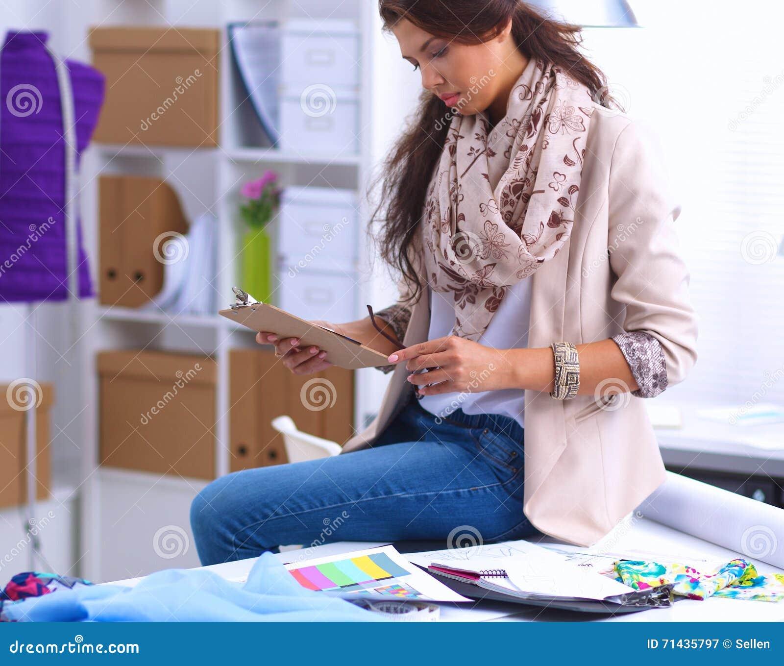 Modern Young Fashion Designer Working At Studio Royalty Free Stock Photo
