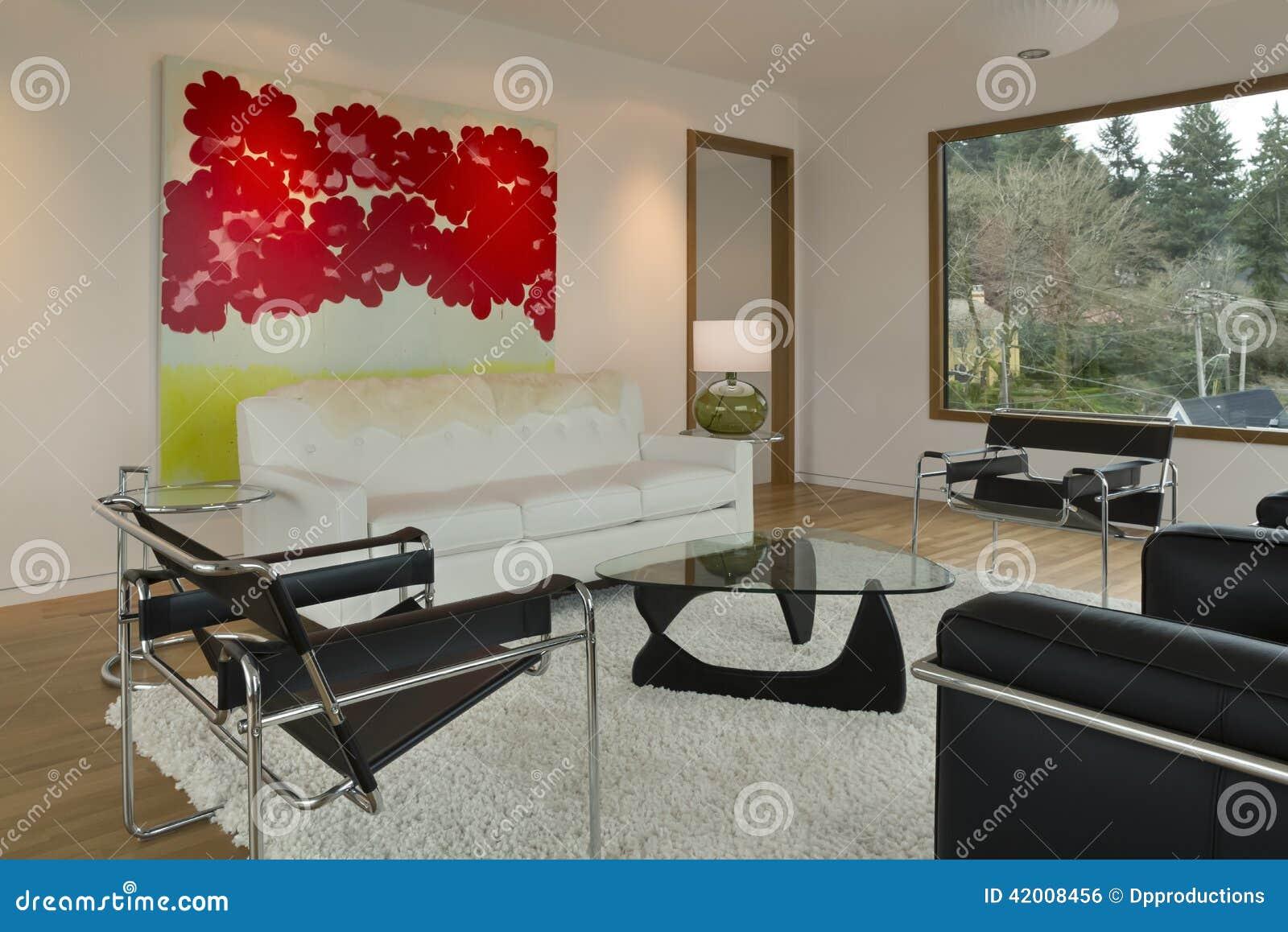 Moderne minimalistische woonkamer met kunstwerk stock foto ...