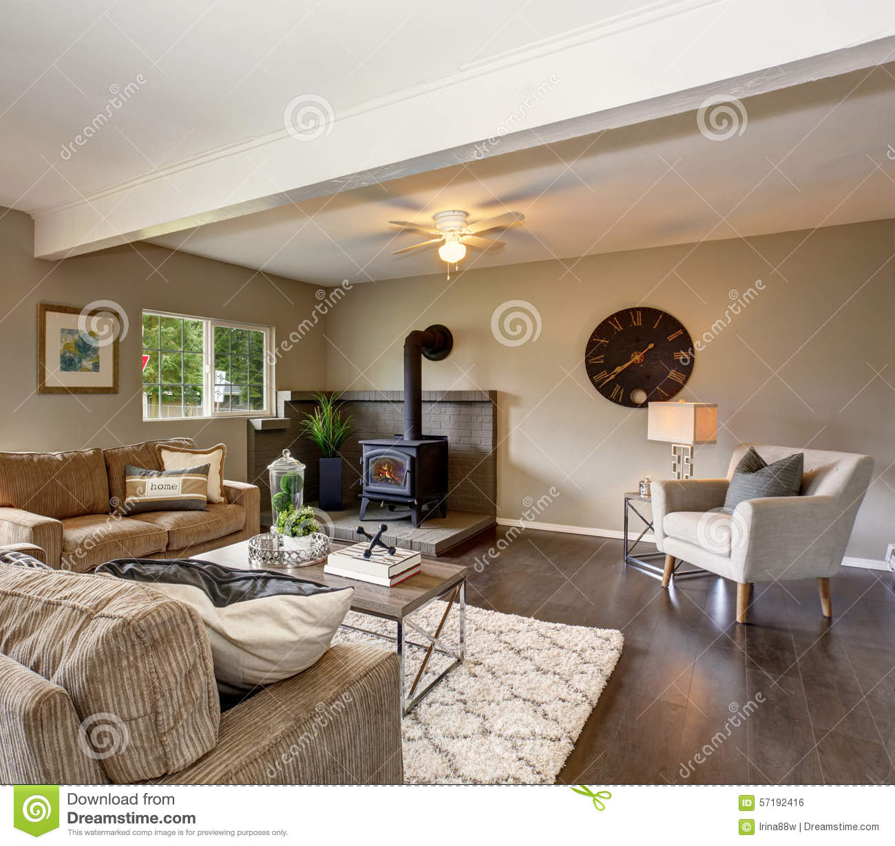 modernized living room with fireplace, and fluffy rug. stock photo