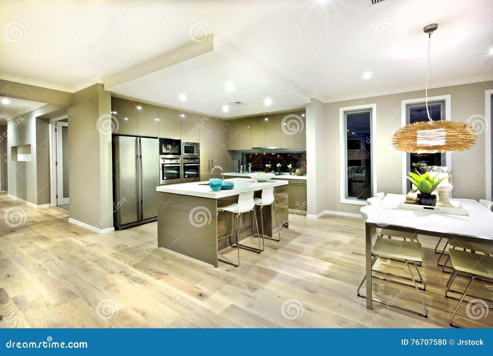 Modernt kök och dinning inre sikt för område av ett hus