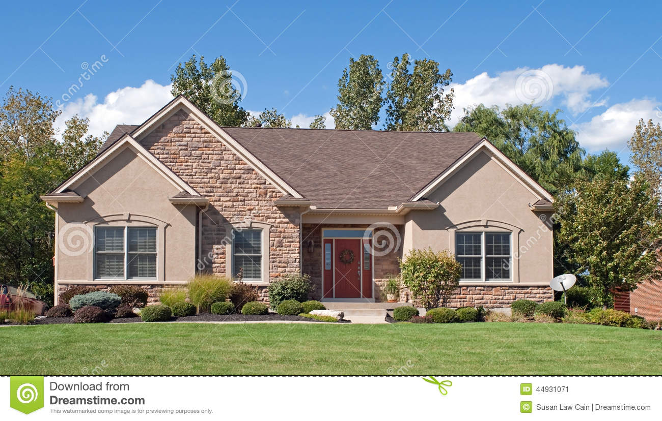 Modest stone stucco house stock image image of for Stone and stucco home designs