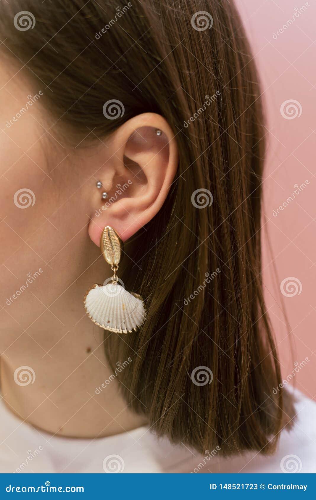 Modieuze oorringen met shells