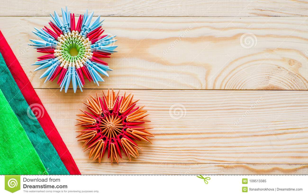 Modular Origami Flowers On Rustic Wooden Background With Paper Stock