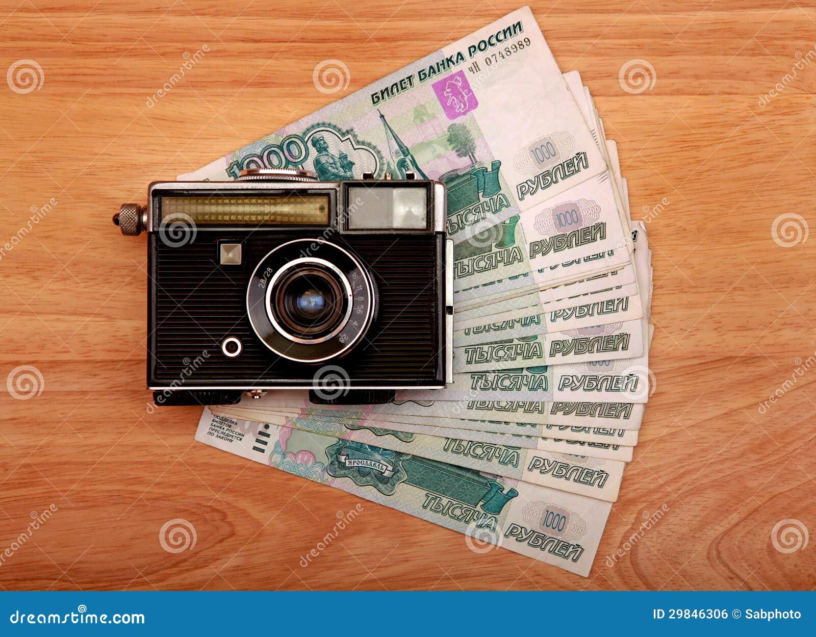 Câmera e dinheiro do vintage