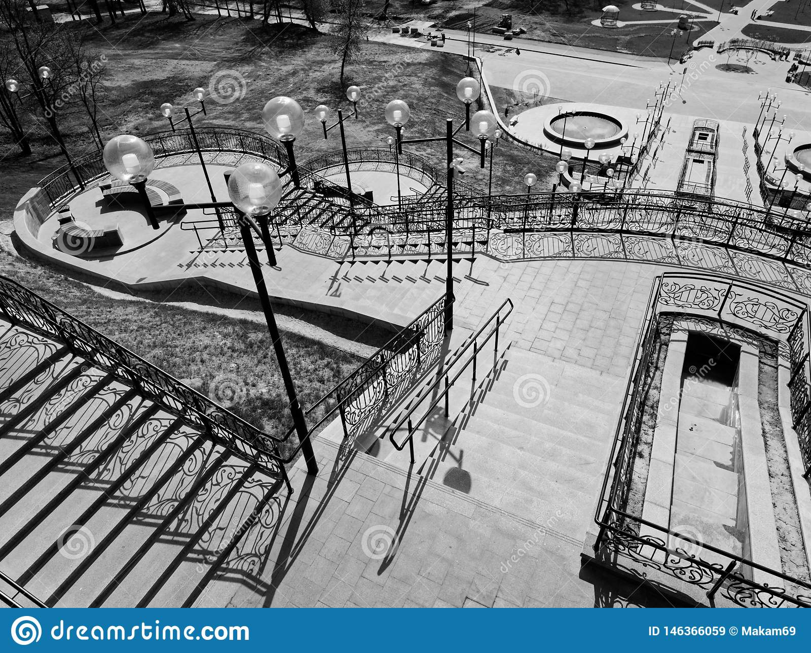 MOGILEV, BELARUS - APRIL 27, 2019: park area with a staircase and a fountain