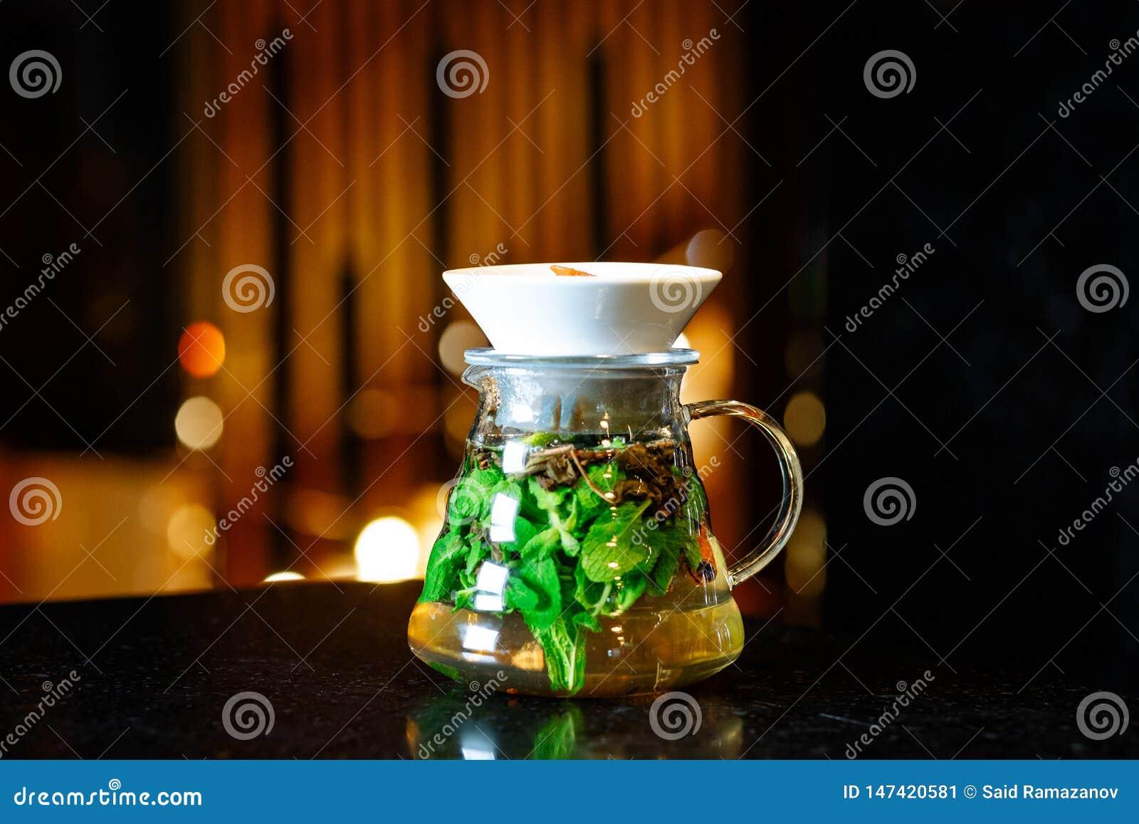 Mojito in a jug on a dark table