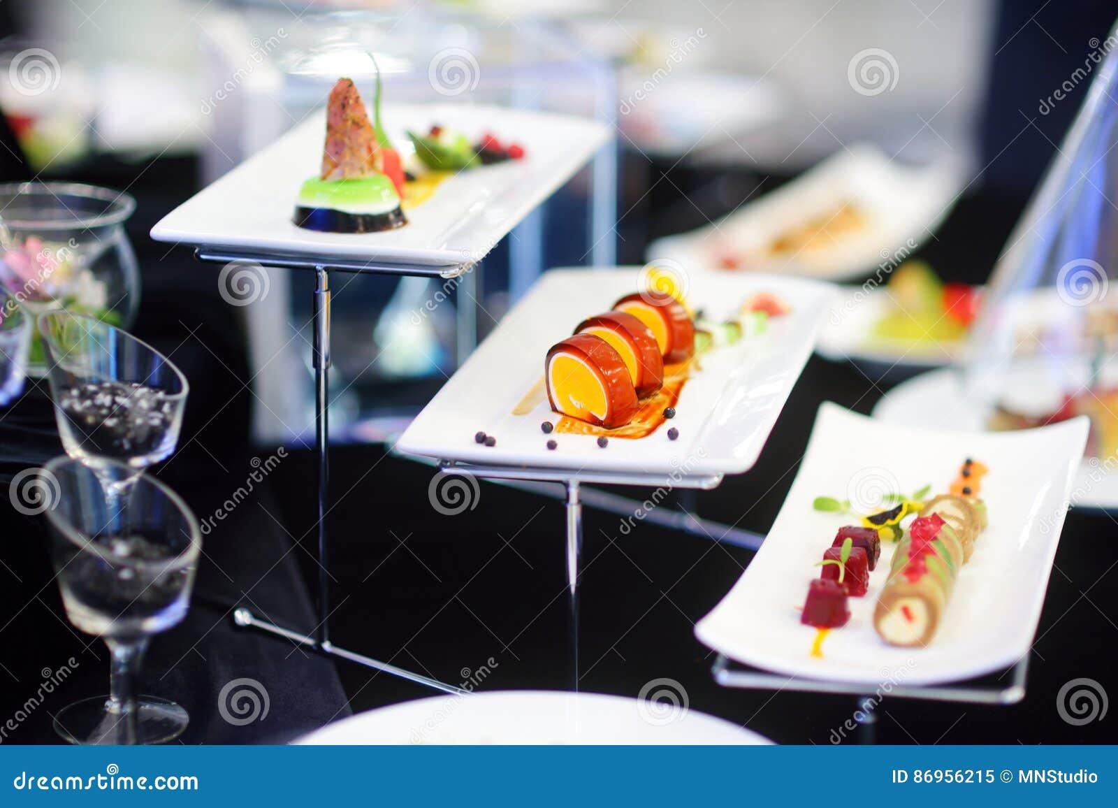molecular modern cuisine various fancy dishes on white plates in  - molecular modern cuisine various fancy dishes on white plates in arestaurant stock photo