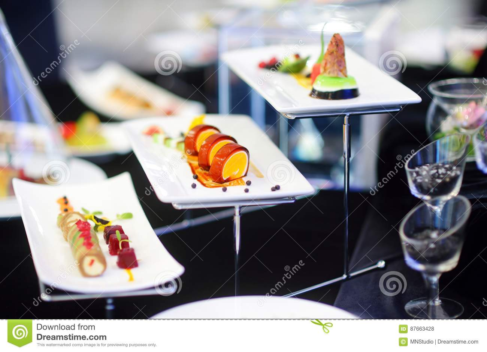 molecular modern cuisine various fancy dishes on white plates in  - cuisine fancy modern