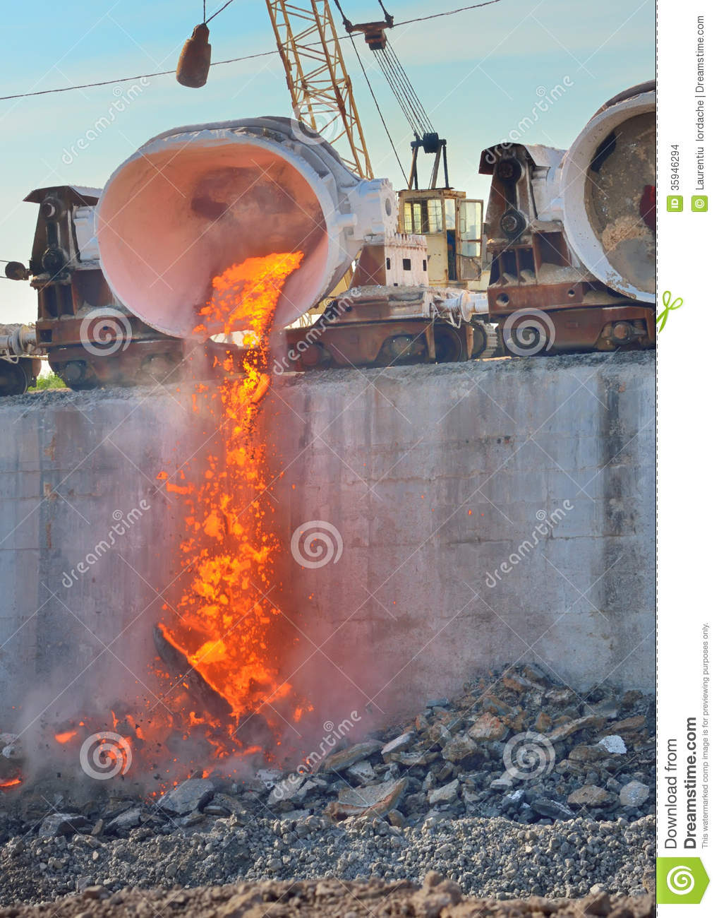 Slag Soil Melted : The molten is poured from a cup on railway platform