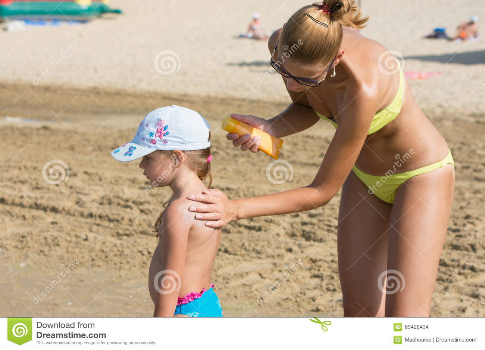 Mom On Beach Gets A Little Girl Back On Sunscreen Stock ...