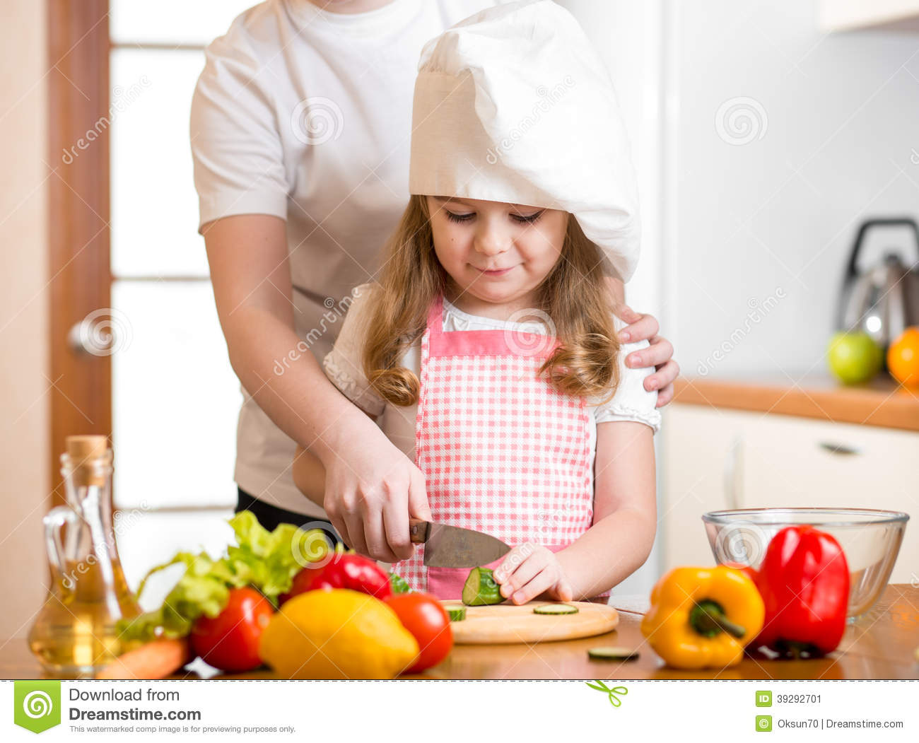 Mom And Child Cook At Kitchen Stock Image
