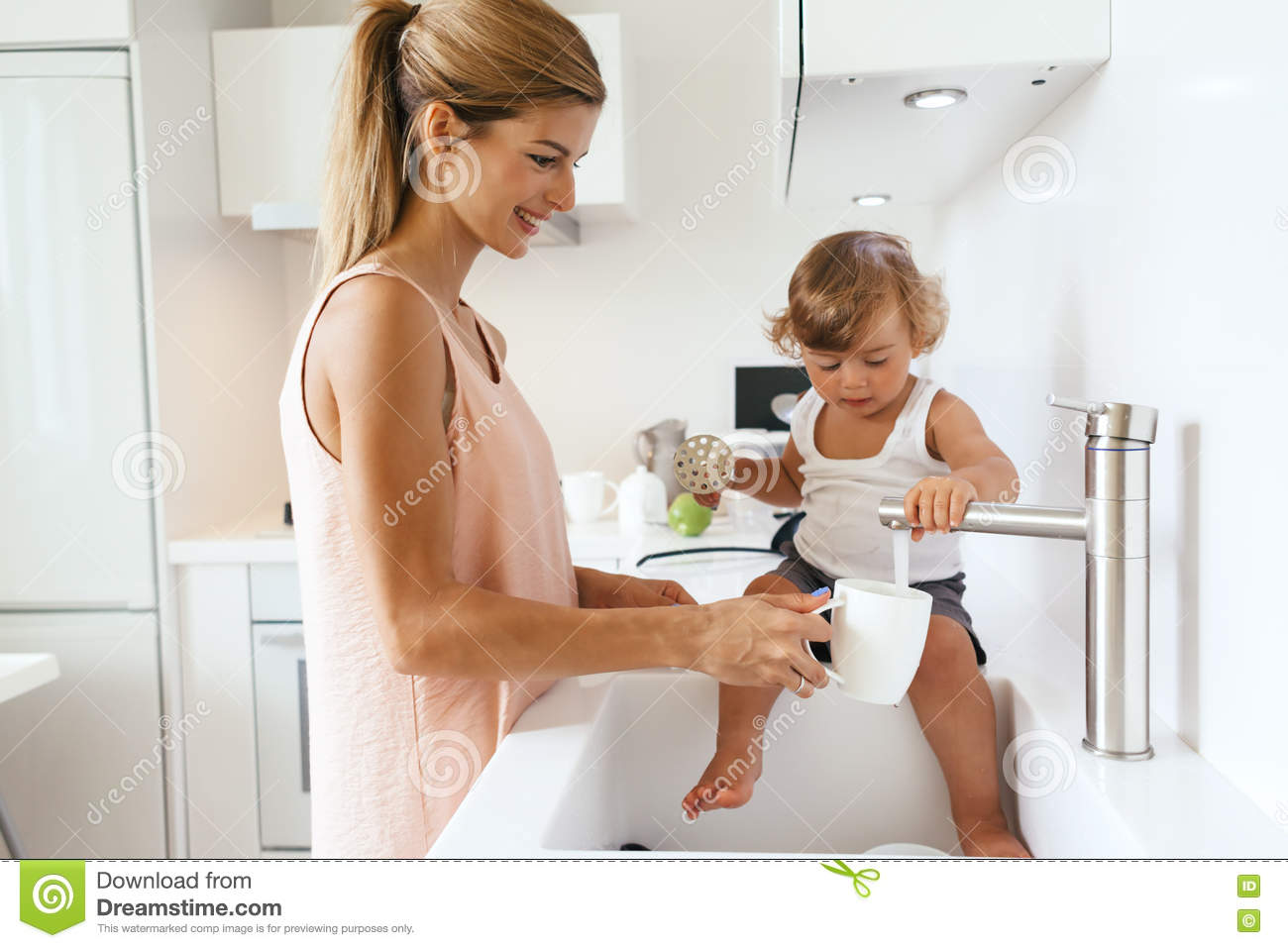 Mom With Child In The Kitchen Stock Image - Image of cooking, food ...